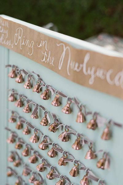 Guests found their seating assignment on these sweet bells prior to the ceremony. As the couple began their recessional, friends and family rang their bells for a melodious exit.