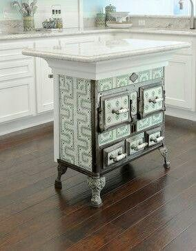 What to do with an antique stove that doesn't work but looks amazing? Use it as a base to a kitchen island! LOVE LOVE LOVE LOVE