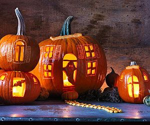 """Ghost town of haunted house made from carved pumpkins. Great for """"fairy"""" village under the tree."""
