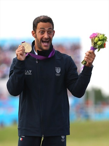 Daniele Molmenti of Italy celebrates winning the gold medal in the men's Kayak Single (K1) Final on Day 5 of the London 2012 Olympic Games. Olympics #Olympics