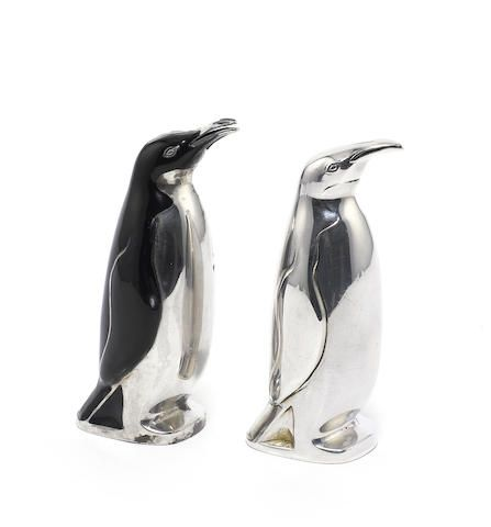 A pair of 20th century Norweigen silver and enamel  novelty 'penguin' salt and pepper pots, by David Andersen, Oslo and a pair of silver-gilt and enamel bottle pourers.  (4)