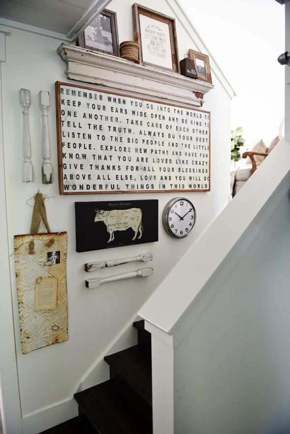 Rustic cottage style staircase gallery wall - how to liven up those staircase walls & give that cozy farmhouse vibe. I love all of the different elements used on this wall: pictures, clocks, banister pieces, sayings etc.