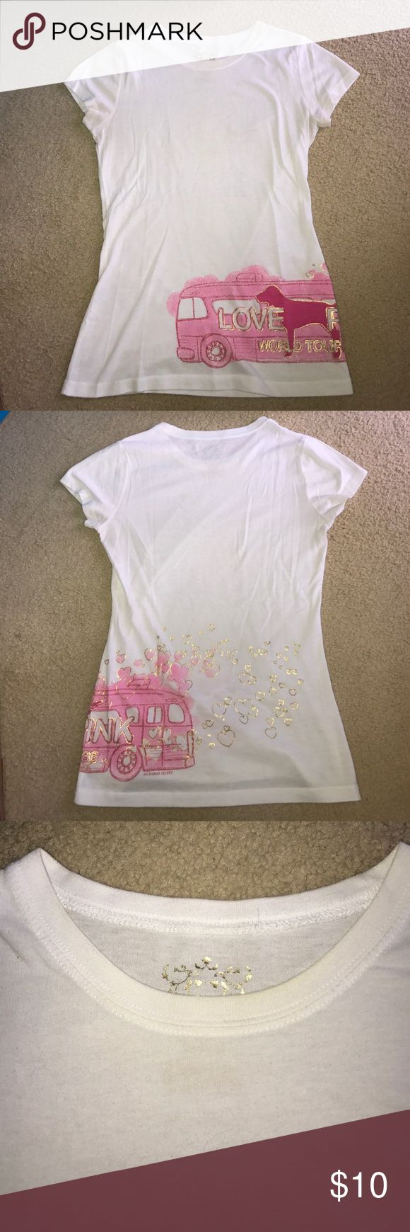 Flash SalePINK World Tour 86 TeePRICE FIRM For sale is a size medium tee by VS PINK!! The bottom features a pink bus and iconic PINK dog with gold foil hearts and the phrase Love PINK World Tour 86. It's a pre-loved shirt and there are natural stains from due to it being a white shirt. They're around the collar and under the arms as shown in the photos. I'm washing it again before selling to get the makeup off the collar from trying it on. Price firm due to limited edition item! PINK…