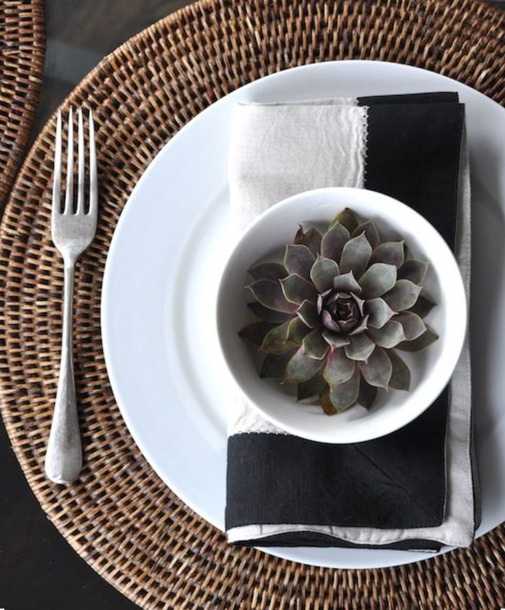 Black and White and a touch of Rattan with our Natural Round Placemats. www.rgimports.com.au