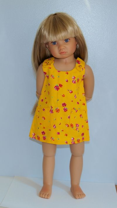 $7.50 yellow floral jumper - 1 available cotton fabric like lightweight denim