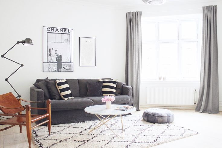Long grey curtains, sofa, leather chair & marble coffee table