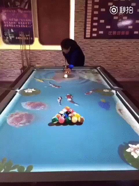 It's a digital pool table. It can be set to ripple like water, have jets of flame follow the balls, move liquid around over an image, and possibly other things.