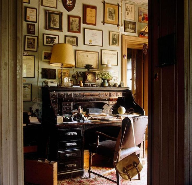 Home Office With Framed Wall Arts And Roll Top Desk