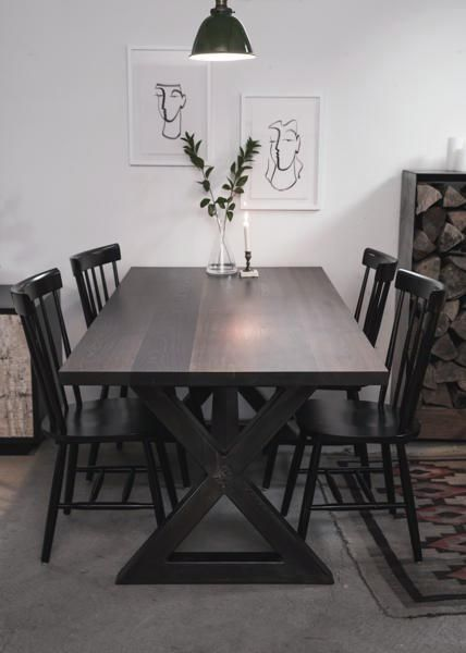 The Picnic Dining Table uniquely pairs a rustic wood surface with an industrial style X-base.