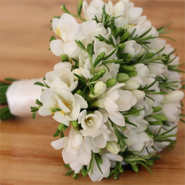 <p>Emma wanted to remember her mother Rosemarie throughout her wedding day and therefore decided to have her chosen florist include Freesias and Rosemary in to her bridal bouquet.</p> <p>Emma wanted something simple and classic when it came to her wedding blooms and Paperwhite Flowers in Spofforth created the perfect collection of bouquets for the bride, her bridesmaids and the reception decor.</p>