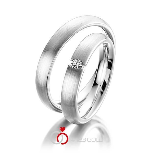 1 Paar Trauringe - Legierung: Weißgold 585/- Breite: 3,50 - Höhe: 1,80 - Steinbesatz: 1 Brillant 0,05 ct. w, si (Ring 1 mit Steinbesatz, Ring 2 Trauringe Steinbesatz)