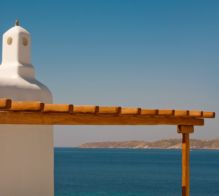 Located on north west part of the resort. The chimney is located next to a rustic wooden pergola - Mykonos Grand Hotel & Resort