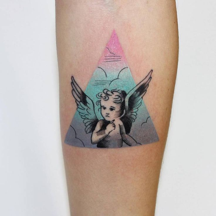 Cherub tattoo on the inner forearm.