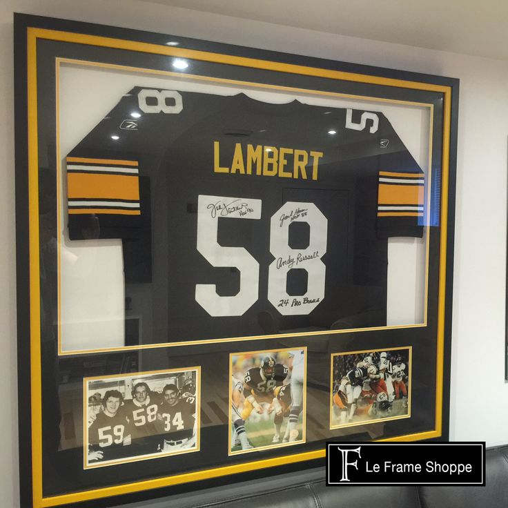 Team colours with the addition of pictures make for a pretty amazing custom-framed jersey!