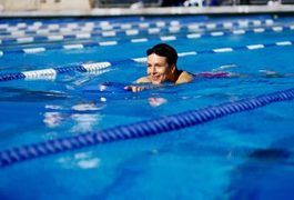 "Let's say you decide to take a swim. In the early morning light, armed with fresh new goggles and a cap, you hit the pool. Images of Michael Phelps and Dara Torres run through your head. But before you finish the first lap, you can hardly breathe. Don't sweat it. ""Swimming takes longer to adapt to than any other sport,"" says..."