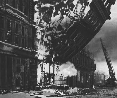 London bombing 1940 - Amazing photo catching the collapse of a building.