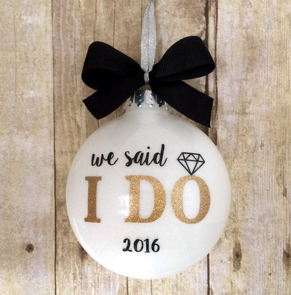 This beautiful We said I Do Ornament features a sparkly white glitter background… More