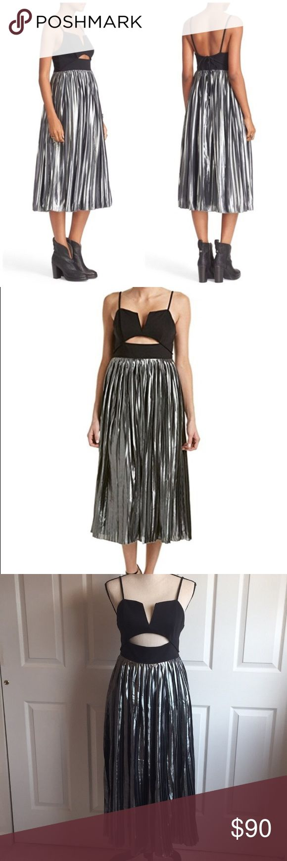 """Free People Piper Dress Free People Piper Pleated Dress in Black and Silver. So glamorous and party ready. Shows off shoulders with a cut out bodice. Accordion pleated skirt part. Hidden back zipper closure. Partially lined. Nylon/ Cotton/ Spandex. Bust;35"""". Wait: 26"""". Height: 5'11"""". Hips: 36"""". New with tags. Free People Dresses Midi"""