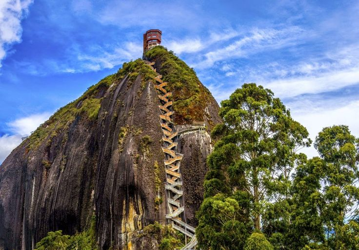 El Peñon de Guatapé A two-hour drive from Medellín, El Peñon de Guatapé is a 650-foot-high monolithic rock with 649 zigzagging stairs built into a single crack that runs top to bottom. It offers picture-perfect views of the surrounding lakes and islands. A group of friends managed to scale the rock in the 1950s, which reportedly took them five days. Eventually the staircase was built and a tourist attraction was born