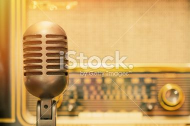 Microphone with an antique radio background Royalty Free Stock Photo