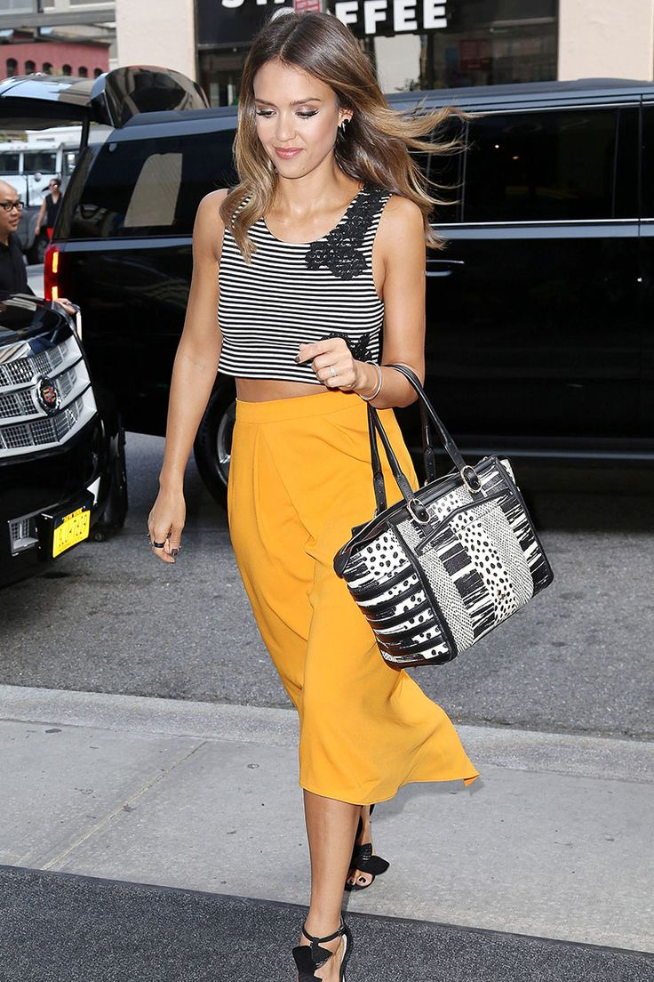 Jessica Alba lands on Derek Blasberg's Best Dressed Celebrities of the Week—see which other celebs made the cut here. Yellow mustard a-like skirt black and white crop top flawless glamour easy outfit weekend date night