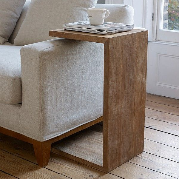 These side tables are amazing. Vertically, they can rest over the sofa arm; or horizontally they can act as longer, lower side tables.