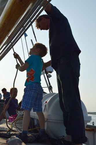 The kids gets to help out with the sails - Sailing with Mjölner / Æblegaarden B&B, Langeland, Denmark, www.aeblegaarden.dk Photo by Sannie Terese Burén