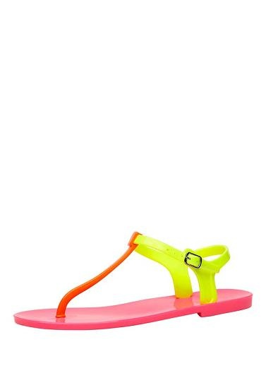 PVC Flat jelly sandal with adjustable buckle strap.