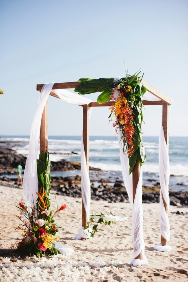 Get married on the beach with the waves crashing behind you and the sun shinning on your face. Magical Hawaiian wedding.