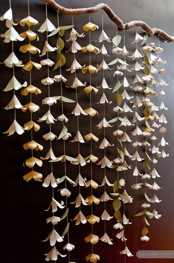 Instead of using traditional wallpaper as a backdrop, DIY a paper flower garland. Source: The Elli Blog