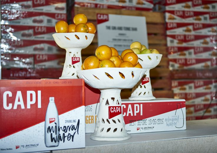Bowls, Oranges and CAPI Sparkling Mineral Water.