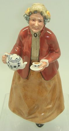 'Tea Time' (1966) Royal Doulton Figurine. A charming lady stands and pours a cup of tea. A favorite of collector's!