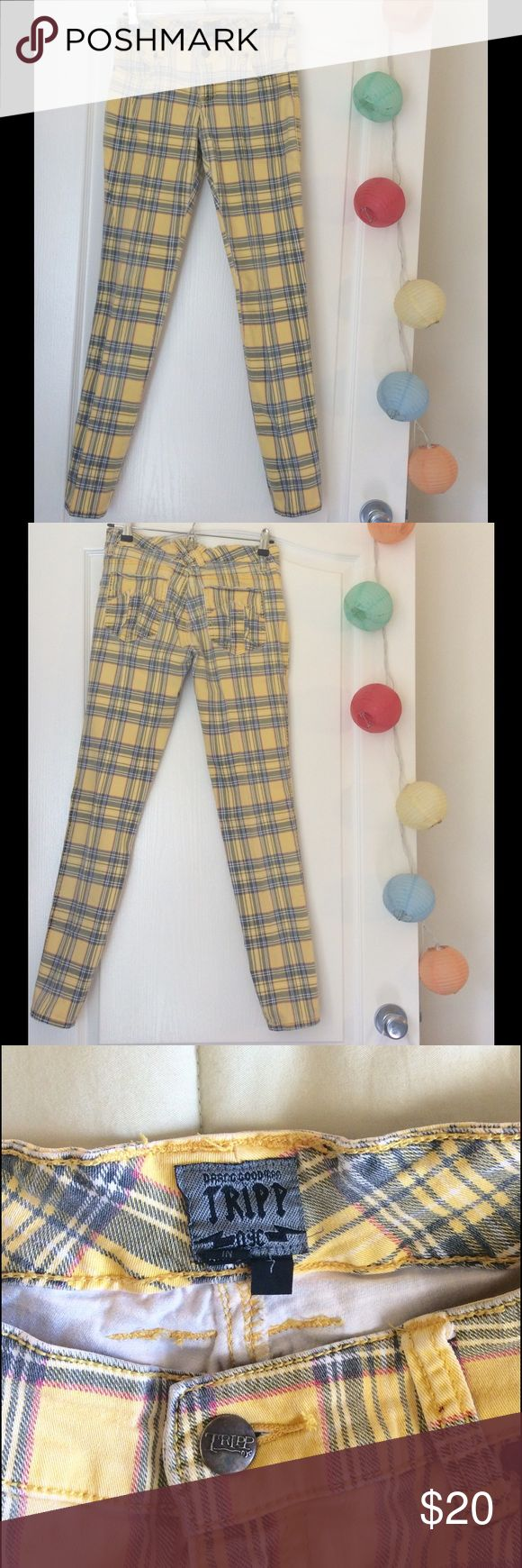Tripp NYC jeans with cute skull detail! Yellow plaid Tripp NYC pants Size 7 true to size. Lowe rise. Good condition but I really loved those pants so the color is a little faded from wear and wash. No major flaws but there is a small pinhead sized ink stain on the leg and the back belt loop has some fluff that pokes out. If you love it make me an offer! Tripp nyc Jeans Skinny