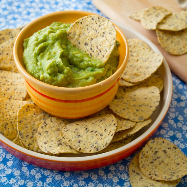 Classic guacamole recipe made with avocado, lime and salt with a bit of salsa, cilantro and garlic. Healthy, naturally gluten free and only 86 calories per 1/4 cup serving. #eatcleanpinparty
