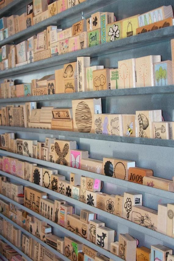 """21 Hacks To Help You Organize Your Art Studio In 2016. <3  Ok, now I'm thinking """"what's big enough to hold ALL my stamps, using rain gutters?"""". Of course!  A little mini-shed you get at Lowe's, and put together yourself!  Make it water tight, finish it and line the walls with gutters... and viola!  My own Stamp Barn.  A sturdy card table in the center, and it's perfect  :D  I like it!"""