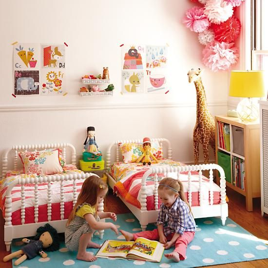 Jenny Lind Toddler Bed in Beds | The Land of Nod. Yes, yes, beds are adorable but how about those sweet paper flower poms in the corner? Would make a great piece hanging from the ceiling in Em's room?