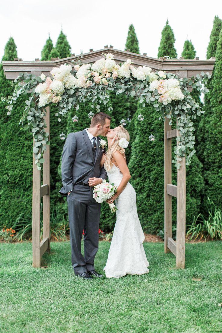 Asheville wedding, ceremony arch, wooden arbor, white hydrangeas, eucalyptus leaves // Forage + Film