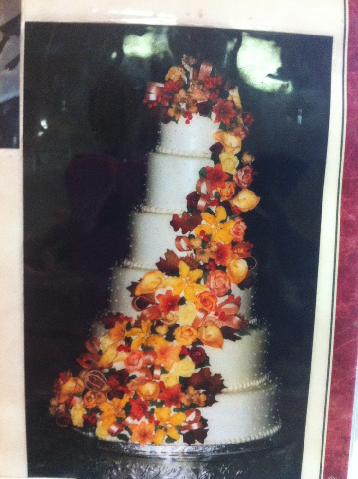 Cascade flower white cake. 4 tier. (6 tier shown in this picture). Flowers include: Chrysanthemums Cremones, Coxcomb, Sunset Lillies & Sunset Calla Lillies, McKora  Orchids and Various Succulents