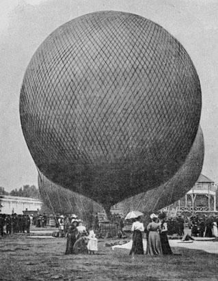 The Olympic Games were held during the Great Exposition in Paris, 1900. This image shows spectators looking at the hot air balloons in the park at Vincennes. Balloon pilots at the Paris Olympics were judged on distance traveled, time in the air, and ability to land at predetermined coordinates. The sport was removed from the Olympic roster, because of a ban on motorized sports. (Popperfoto/Getty Images)