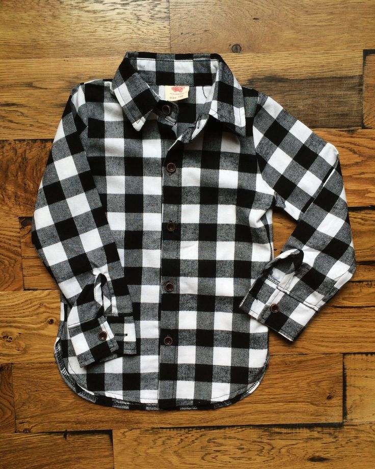 This super soft, long White and Black Plaid Flannel Shirt is a must have in every little girl's fall closet. Pair it with leggings or jeans and a Glitter Bow Headband and she'll be ready for any fall