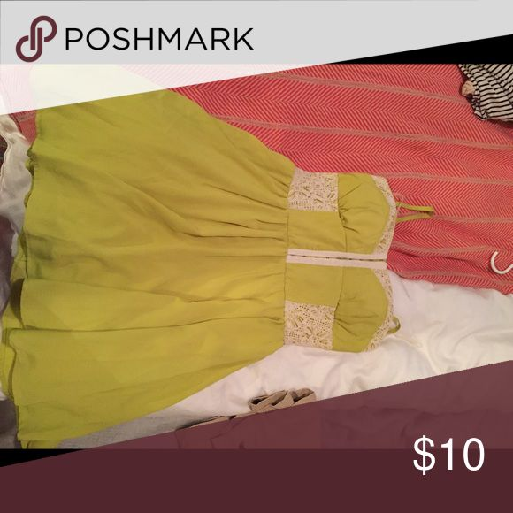 Bustier chartreuse dress This cute summer dress is in perfect condition. Has a little lace detail on it and zips in the back. Adjustable straps. Size 9 but fits like a medium Dresses Midi
