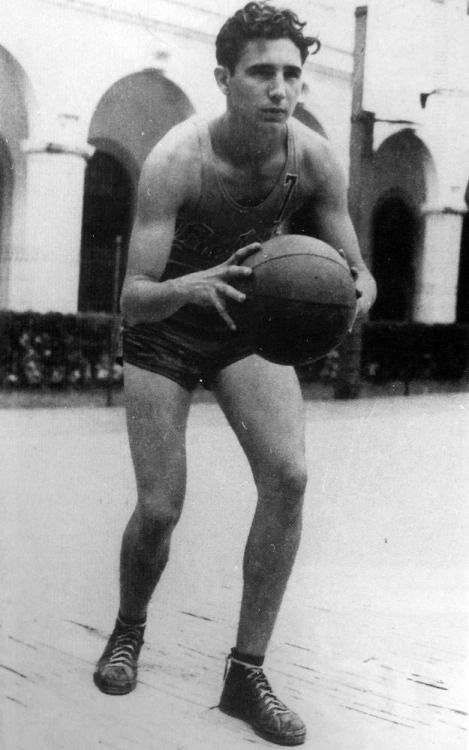 A 17 year old Fidel Castro plays basketball at his High School in 1943 - via reddit[[MORE]]namraka:More photos: Fidel Castro in his High School yearbook, 1945 At a press conference in New York, 1955 Learning to ski during a trip to the USSR, 1962 Trying on a pair of sunglasses in Havana, 1999