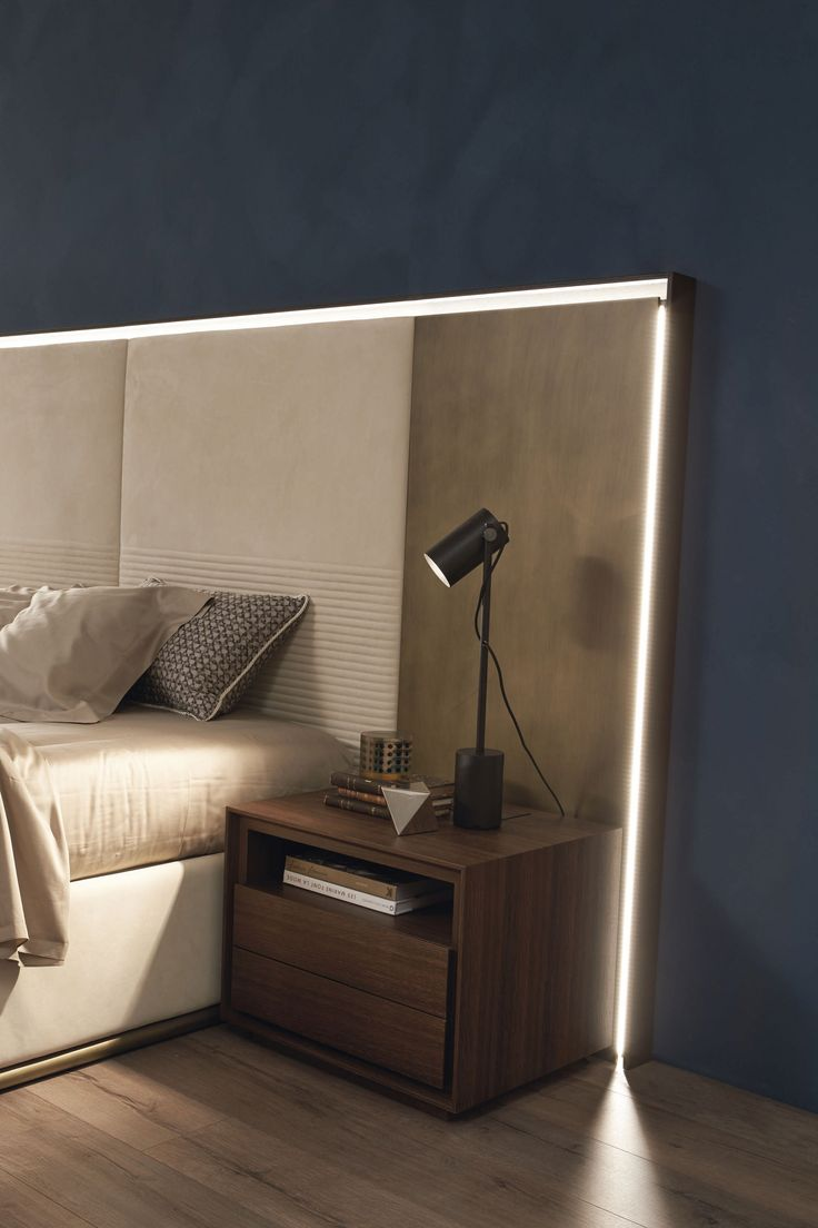 letto frame by fimes The important headboard of Frame bed with the union of lacquered finishes in antique bronze, nabuk leather and solid wood frame, with Led light.design Marconato & Zappa#bedroom #closet #slidingdoors #leafdoors #interiordesign #design #modern #contemporary #madeinitaly #salonedelmobile #fieradelmobile #isaloni #fieramilano #luxury #glamour #artdeco #fimes #dresser #tvunit #sofa