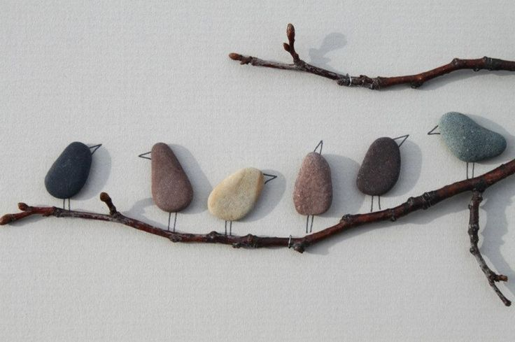 I love these adorable birds on a branch made from smooth stones or pebbles. Such a fun piece of garden art or a fun nature activity for kids.