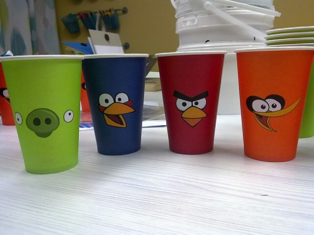 Plain coloured cups and some printed bird faces glued on to them.