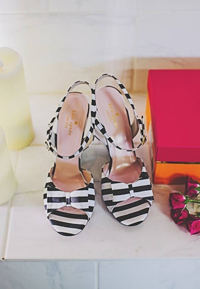 Beautifully modern black and white striped wedding shoes by Kate Spade. Photo: Teale Photography
