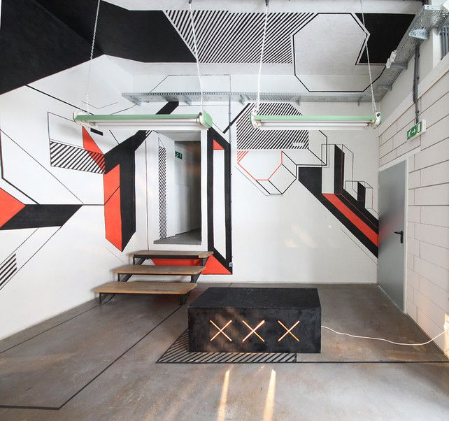 Late Architects, a Polish studio, managed to design a snazzy space in Poland with remarkably few resources. Using just paint, wood, and a hell of a lot of tape--some 3,000 feet of the stuff--they covered part of a coworking space in Kraków in bold, black-white-and-red graphics and geometric letters that look like a Constructivist poster, deconstructed.