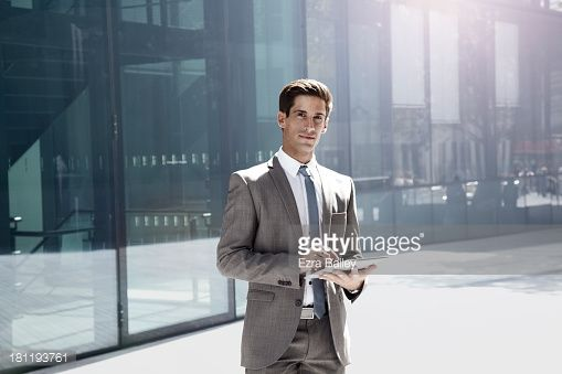Stock Photo : Portrait of a businessman using a tablet.