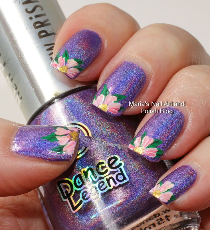 the purple holo polish under the flowers!! AMAZING!!  Floral French nail art on Cosmic Raibow