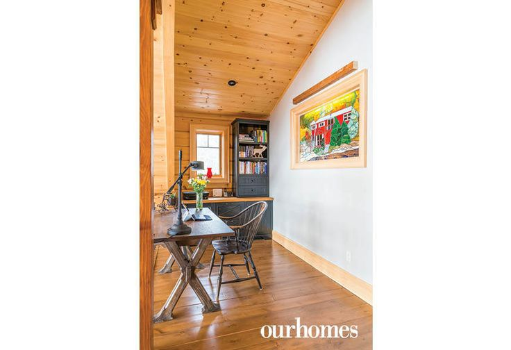 """An illuminated stained-glass window glows over the office loft.    See more of this home in """"Fifth Generation Legacy on Muskoka's Moon River"""" from OUR HOMES Muskoka Early Summer 2017: http://www.ourhomes.ca/articles/build/article/fifth-generation-legacy-on-muskokas-moon-river"""
